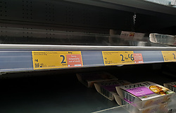 © Licensed to London News Pictures. 09/10/2021. London, UK. 'Sorry temporarily out of stock' label on display on the Morrisons Ready to Cook Chicken Brie & Bacon shelf in Morrisons, north London amid fears of shortage of essential items leading up to Christmas due to labour shortages following Brexit. According to figures from the Office of National Statistics, one in six people in the UK have been unable to buy essential foods in the past two weeks and the Army could be drafted in to drive HGVs over Christmas as the supply chain crisis continues. Photo credit: Dinendra Haria/LNP