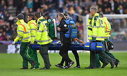 Huddersfield Town's Chris Lowe leaves the pitch on a stretcher during the Premier League match at the John Smith's Stadium, Huddersfield.