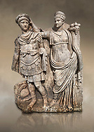 Roman Sebasteion relief  sculpture of Nero being crowned emperor by Agrippina, Aphrodisias Museum, Aphrodisias, Turkey.  Against an art background.<br /> <br /> Agrippina crowns her young son Nero with a laurel wreath. She carries a cornucopia, a symbol of Fortune and Plenty, and he wears the armour and cloak of a Roman commander, with a helmet on the ground near his feet. The scene refers to Nero's accession as emperor in AD 54, and belongs before AD 59 when Nero had Agrippina murdered. .<br /> <br /> If you prefer to buy from our ALAMY STOCK LIBRARY page at https://www.alamy.com/portfolio/paul-williams-funkystock/greco-roman-sculptures.html . Type -    Aphrodisias     - into LOWER SEARCH WITHIN GALLERY box - Refine search by adding a subject, place, background colour, museum etc.<br /> <br /> Visit our ROMAN WORLD PHOTO COLLECTIONS for more photos to download or buy as wall art prints https://funkystock.photoshelter.com/gallery-collection/The-Romans-Art-Artefacts-Antiquities-Historic-Sites-Pictures-Images/C0000r2uLJJo9_s0