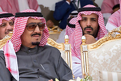 """File photo - L-R : King Salman Bin Abdul Aziz Al Saud, and his son Defense Minister Mohammed Bin Salman Al Saud attend military drill """"Northern Thunder"""" in Hafr Al Batin area, north of Saudi Arabia, on March 11, 2016. A new Saudi anti-corruption body has detained 11 princes, four sitting ministers and dozens of former ministers, media reports say. The detentions came hours after the new committee, headed by Crown Prince Mohammed bin Salman, was formed by royal decree. Photo by Balkis Press/ABACAPRESS.COM"""