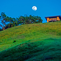 The moon rises over a luxury home near Briones Regional Park in the East San Francisco Bay Area of California.