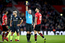 Southampton's Charlie Austin (right) receives a yellow card from Referee Paul Tierney for unsporting behaviour during the Premier League match at St Mary's Stadium, Southampton.