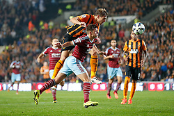 Nikica Jelavic of Hull City and Aaron Cresswell of West Ham compete in the air - Photo mandatory by-line: Rogan Thomson/JMP - 07966 386802 - 15/09/2014 - SPORT - FOOTBALL - KC Stadium, Hull - Hull City v West Ham United - Barclays Premier League.