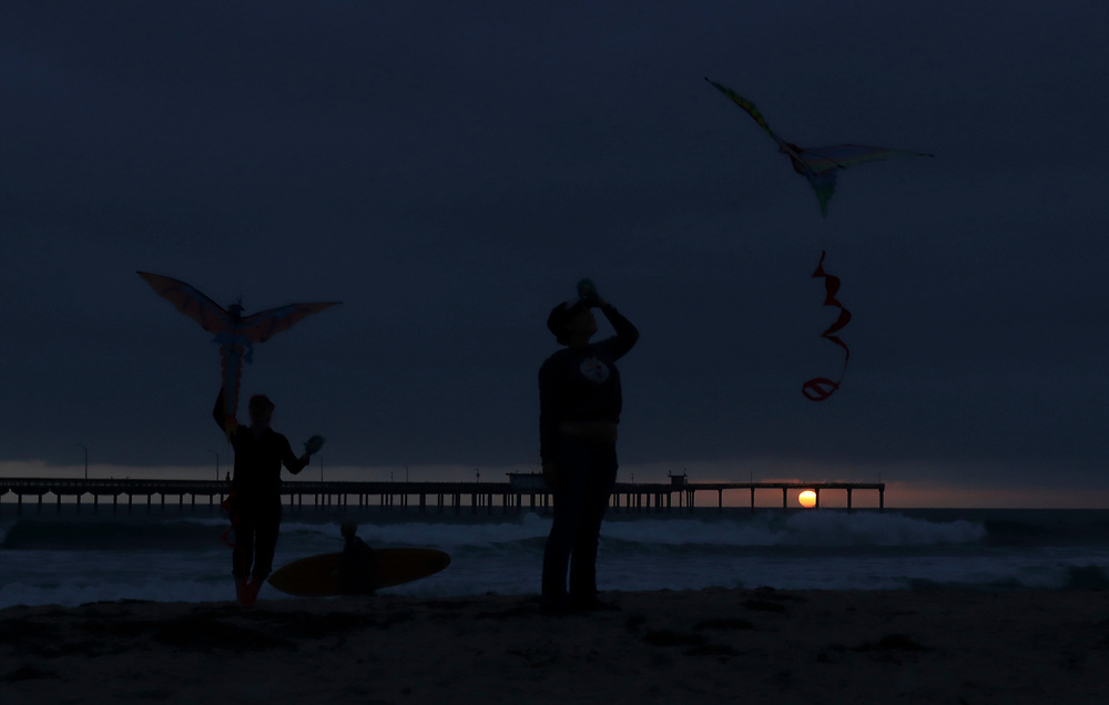 People do acrobatics along the shore in Ocean Beach on Wednesday, May 19, 2021.(Photo by Sandy Huffaker