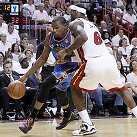 21 June 2012: Oklahoma City Thunder small forward Kevin Durant (35) drives past Miami Heat small forward LeBron James (6) during the Miami Heat 121-106 victory over the Oklahoma City Thunder, in Game 5 of the 2012 NBA Finals, at the AmericanAirlinesArena, Miami, Florida, USA. The Miami Heat wins the series 4-1.