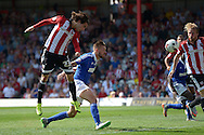 Jota of Brentford heads the ball from a cross. Skybet football league Championship match, Brentford v Ipswich Town at Griffin Park in London on Saturday 8th August 2015.<br /> pic by John Patrick Fletcher, Andrew Orchard sports photography.