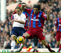 Fotball<br /> Premier League 2004/05<br /> Tottenham v Crystal Palace<br /> 28. desember 2004<br /> Foto: Digitalsport<br /> NORWAY ONLY<br /> Reto Zeigler of Tottenham gets a shot away in the first half as Gonzalo Sorondo of Palace tries to stop him