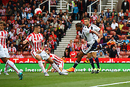 Jose Salomon Rondon of West Bromwich Albion shoots at goal but sees his shot blocked by Geoff Cameron of Stoke City. Barclays Premier League match, Stoke city v West Bromwich Albion at the Britannia stadium in Stoke on Trent, Staffs on Saturday 29th August 2015.<br /> pic by Chris Stading, Andrew Orchard sports photography.