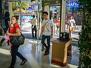 04 APRIL 2013 - BANGKOK, THAILAND:  Shoppers walk through a metal detector to enter a Bangkok shopping mall. The United States' Federal Bureau of Investigation (FBI)  has warned the Thai government that Thailand has the greatest risk of a terror attack in Asia and the fifth greatest in the world. According to a statement from the Thai government the assessment is based on Thailand's relative freedoms and ease of movement in Thailand. In response to the report, Deputy Prime Minister Chalerm Yubamrung announced plans to set up an anti-terror center in Bangkok and work with Thai immigration to institute tougher screening on foreigners entering Thailand. In February 2012, terrorists thought to be connected with the Iranian government were arrested in Bangkok after the house they were living in blew up. At the time, Thai authorities said they suspected it was a bomb factory.    PHOTO BY JACK KURTZ