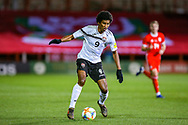 Trinidad and Tobago forward Willis Plaza on the ball during the Friendly European Championship warm up match between Wales and Trinidad and Tobago at the Racecourse Ground, Wrexham, United Kingdom on 20 March 2019.