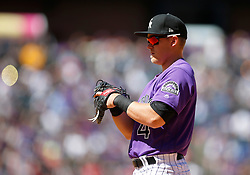 April 8, 2018 - Denver, CO, U.S. - DENVER, CO - APRIL 08: Colorado Rockies infielder Pat Valaika (4) stands at first base during a regular season MLB game between the Colorado Rockies and the visiting Atlanta Braves on April 8, 2018 at Coors Field in Denver, CO. (Photo by Russell Lansford/Icon Sportswire) (Credit Image: © Russell Lansford/Icon SMI via ZUMA Press)