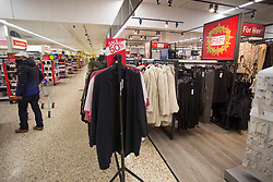 "© Licensed to London News Pictures. 10/11/2020. London, UK. The clothing section of Tesco Extra in Edmonton, north London is not blocked, while in other stores it is a ""non-essential"" item. Photo credit: Marcin Nowak/LNP"
