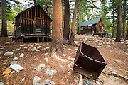 Mining cabins and ore car at the Mammoth Consolidated Gold Mine, Inyo National Forest, Mammoth Lakes, California USA
