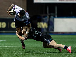 Rey Lee-Lo of Cardiff Blues is tackled by Nick Grigg of Glasgow Warriors<br /> <br /> Photographer Simon King/Replay Images<br /> <br /> Guinness PRO14 Round 15 - Cardiff Blues v Glasgow Warriors - Saturday 16th February 2019 - Cardiff Arms Park - Cardiff<br /> <br /> World Copyright © Replay Images . All rights reserved. info@replayimages.co.uk - http://replayimages.co.uk