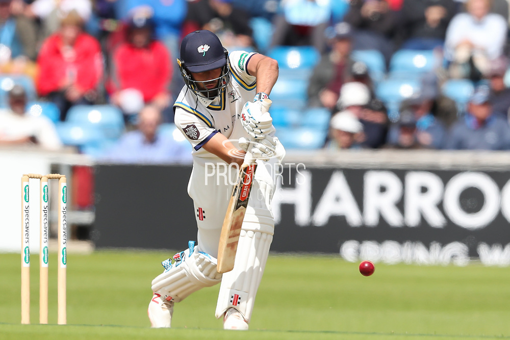 Jack Leaning of Yorkshire place a defensive shot during the opening day of the Specsavers County Champ Div 1 match between Yorkshire County Cricket Club and Hampshire County Cricket Club at Headingley Stadium, Headingley, United Kingdom on 27 May 2019.