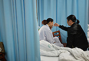 WUHAN, CHINA - APRIL 02: (CHINA OUT) <br /> <br /> 7-year-old Boy Donates Kidney To His Mother After he Died<br /> <br /> Zhou Lu and her mother-in-law cry in the ward as Zhou\'s 7-year-old son died at 4:15 a.m. on April 2, 2014, in Wuhan, Hubei Province of China. Chen Xiaotian, a 7-year-old boy died from malignant brain tumors at 4 a.m. on April 02, 2014. He donated his left kidney to his mother Zhou Lu who suffered from uremia and can only cured by a kidney transplant. Chen was diagnosed with malignant brain tumor when he was five-and-a-half years old and has lost his vision in both eyes early this year due to the exacerbation of his brain tumors. Chen also donated his right kidney to a 21-year-old woman and his liver to a 27-year-old man. The operation was both completed on Wednesday. <br /> ©Exclusivepix