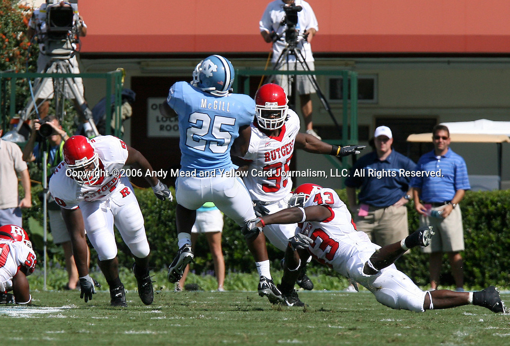 02 September 2006: UNC's Ronnie McGill (25) spins out of a tackle by Rutgers Ron Girault (43) starting a 48 yard run down the sideline. The University of North Carolina Tarheels lost 21-16 to the Rutgers Scarlett Knights at Kenan Stadium in Chapel Hill, North Carolina in an NCAA Division I College Football game.