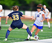 Althoff defender Jenna Roper (left) and Columbia defender Kyra Bivins vie for the ball. Althoff played Columbia in the sectional championship game at Althoff High School in Belleville, IL on Friday June 11, 2021. <br /> Tim Vizer/Special to STLhighschoolsports.com.