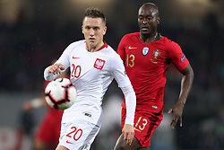 November 20, 2018 - Guimaraes, Guimaraes, Portugal - Piotr Zielinski midfielder of Poland (L) in action with Danilo Pereira defender of Portugal (R) during the UEFA Nations League football match between Portugal and Poland at the Dao Afonso Henriques stadium in Guimaraes on November 20, 2018. (Credit Image: © Dpi/NurPhoto via ZUMA Press)