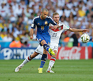 Javier Mascherano of Argentina and Christoph Kramer of Germany during the 2014 FIFA World Cup Final match at Maracana Stadium, Rio de Janeiro<br /> Picture by Andrew Tobin/Focus Images Ltd +44 7710 761829<br /> 13/07/2014