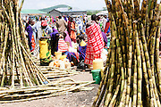 Africa, Tanzania, Frontier Market selling sugar cane The goods are placed on a blanket on the ground