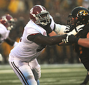 Alabama Crimson Tide defensive lineman Quinton Dial (90) battles the Missouri Tigers in the first half. The Alabama Crimson Tide defeated the Missouri Tigers 42-10 at Memorial Stadium in Columbia, Missouri on October 13, 2012.