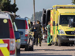 © Licensed to London News Pictures. 30/08/2016. Bognor Regis, UK. Police and paramedics surround a house where a man was involved in an armed siege in Pagham. A 72 year old man  has been in a stand-off with police since 4pm on Sunday.  Photo credit: Peter Macdiarmid/LNP