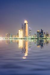Evening view of modern skyline in Abu Dhabi in United Arab Emirates UAE
