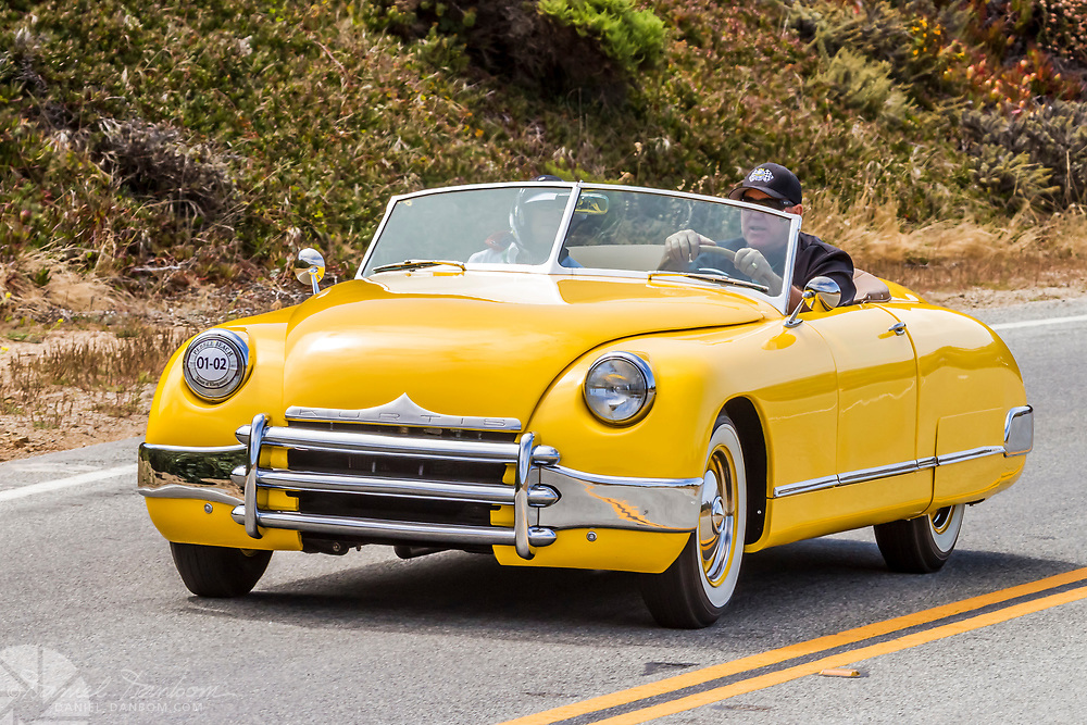 1949 Kurtis Sports Car in the Tour d Elegance, along Highway 1 on the Big Sur Coast. Classic and Historic autos participate in the Pebble Beach, Concours d Elegance, take to the highway to tour the Monterey Peninsula and coast.