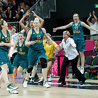 30 July 2012: Team Australia celebrates a buzzer beater shot by Belinda Sneel to go in overtime during the 74-70 Team France overtime victory over Team Australia, during the women's basketball preliminary, at the Basketball Arena, in London, Great Britain.