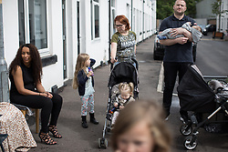 September 4, 2017 - Manchester, Greater Manchester, UK - Manchester , UK . Children and families out playing in the street as Prince Harry visits the Walking With the Wounded ( WWTW) hub on Canada Street , Newton Health .  WWTW helps ex-service personnel with physical or mental health needs make the transition back to civilian life . The street was subject to an episode of DIY SOS when people gave their time and resource to help redevelop the houses  (Credit Image: © Joel Goodman/London News Pictures via ZUMA Wire)