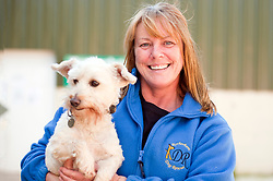 Ann Diaz Rotherham Dog Rescue Charity Trustee with Dylan the Westie Poodle Cross breed<br /> 121129<br /> <br /> 11 July 2012<br /> Image © Paul David Drabble