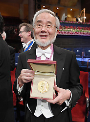 """Nobelpreisverleihung 2016 in der Konzerthalle in Stockholm / 101216 ***Nobel laureate Yoshinori Ohsumi shows his medal after an award ceremony in Stockholm on Dec. 10, 2016. Ohsumi was awarded the Nobel prize in physiology or medicine for elucidating """"autophagy,"""" an intracellular process that degrades and recycles proteins."""