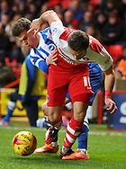 Solly March tackling Simon Church during the Sky Bet Championship match between Charlton Athletic and Brighton and Hove Albion at The Valley, London, England on 10 January 2015. Photo by Matthew Redman.