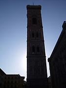 Giotto's Campanile or Tower at the Basilica di Santa Maria del Fiore (English: Basilica of Saint Mary of the Flower) is the cathedral church of Florence, Italy. The Duomo, as it is ordinarily called, was begun in 1296 in the Gothic style to the design of Arnolfo di Cambio and completed structurally in 1436 with the dome engineered by Filippo Brunelleschi. The exterior of the basilica is faced with polychrome marble panels in various shades of green and pink bordered by white and has an elaborate 19th century Gothic Revival façade by Emilio De Fabris. The cathedral complex, located in Piazza del Duomo, includes the Baptistery and Giotto's Campanile