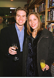 MR PAUL ROBINSON and MISS KATY KASS daughter of actress Joan Collins, at a party in London on 2nd December 1998.MMO 5