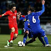 Turkey's Arda Turan (L) during the FIFA World Cup 2014 qualification match Andorra betwen Turkey at the Andorra la Vella stadium in Andorra March 22, 2013. Photo by TURKPIX