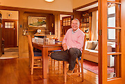 Theatre designer and tutor Brian King photographed at his home in Wellington. Some set models are on the table beside him. Brian King graduated from Toi Whakaari with a Advanced Diploma of Technical Production in 2003 and a Bachelor of Performance Design in 2006.