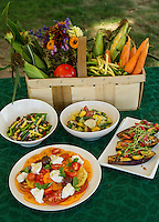Jonathan Diola prepared dishes from Moulton Farm's summer bounty to accompany your Labor Day BBQ.  (top l-r) Mrs. Miner's 4 bean salad, potato salad with yellow and green squash and green beans, roasted eggplant with tomato, onion and pea sprouts followed by Heirloom tomatoes with fresh mozzarella (Burrata) and basil.  (Karen Bobotas/for the Laconia Daily Sun)
