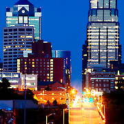 Telephoto view of buildings and structures of downtown Kansas City, Missouri at dusk from 12th Street in the West Bottoms area.