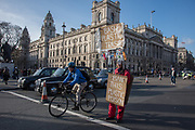 Man protesting about plastic in front of Black cab drivers demonstrating about Mayor Siddiq Khan comments and not being allowed into bus lanes, Parliament Sq. , London. 11 March 2019