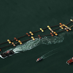 Aerial view of dredging the waters near the Port of Oakland California A