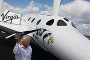 Alongside his SpaceShipTwo vehicle, Richard Branson holds model of satellite LauncherOne after Virgin Galactic space tourism presentation at the 2012 Farnborough Air Show. Virgin Galactic is a company within Richard Branson's Virgin Group which plans to provide sub-orbital spaceflights to space tourists, suborbital launches for space science missions and orbital launches of small satellites.Sir Richard Charles Nicholas Branson (b1950) is an English business magnate, best known for his Virgin Group of more than 400 companies. Branson is the 4th richest citizen of the United Kingdom, according to the Forbes 2011 list of billionaires, with an estimated net worth of US$4.2 billion.