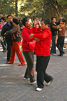 Dancing in Beihai Park - an imperial garden to the northwest of the Forbidden City in Beijing. Originally built in the 10th century, it is among the largest of Chinese gardens and contains numerous historically important structures, palaces and temples.