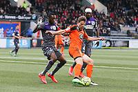 Benjamin JEANNOT / Jean Daniel AKPA AKPRO - 18.04.2015 - Lorient / Toulouse - 33eme journee de Ligue 1<br />Photo : Vincent Michel / Icon Sport