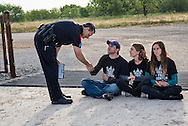 June 1, 2015, Denton, Texas, Sergeant Jenkins thanks Adam Briggle for his service to the community before arresting him and two other members of the Denton Drilling Awareness Group, Tara Linn Hunter  and Niki Chochrek  for criminal trespass. Three members of the Denton Drilling Awareness Group were arrested when they refused to move away from the entrance to a fracking site where work began on June 1 despite a fracking ban the citizens of Denton voted for seven months ago.  Texas Governor Greg Abbott signed legislation, HB 40, that prohibits cities and towns in Texas from banning fracking