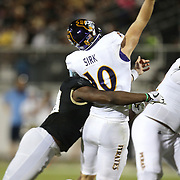 ORLANDO, FL - OCTOBER 14: Titus Davis #10 of the UCF Knights sacks Thomas Sirk #10 of the East Carolina Pirates and forces an interception during a NCAA football game between the East Carolina Pirates and the UCF Knights at Spectrum Stadium on October 14, 2017 in Orlando, Florida. (Photo by Alex Menendez/Getty Images)