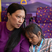 Vanessa Mae Rodel, 42, and her seven-year-old daughter Keana Nihinsa, travel by public bus from Castle Peak Immigration Centre, in Hong Kong on March 18, 2019. / Photo: Maria de la Guardia