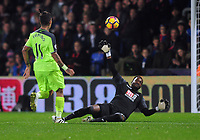Football - 2016 / 2017 Premier League - Crystal Palace vs. Liverpool<br /> <br /> Roberto Firmino of Liverpool chips the ball over Steve Mandanda to score goal no 4 at Selhurst Park.<br /> <br /> COLORSPORT/ANDREW COWIE
