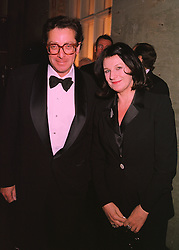 LORD & LADY SAATCHI  at a dinner in London on 26th February 1998.MFT 68